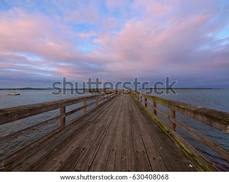Wooden fishing pier extending from the shore into the ocean