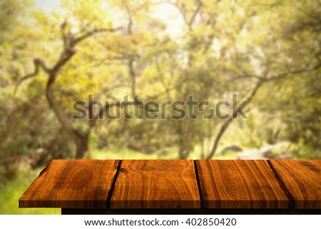 Wooden floor against wooden trail across countryside - stock photo