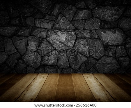 wooden floor and gray cracked stone wall background - stock photo
