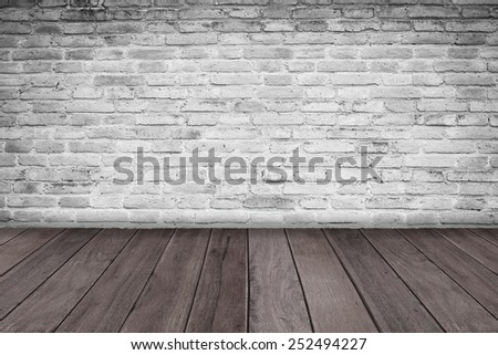 wooden floor and white misty brick wall