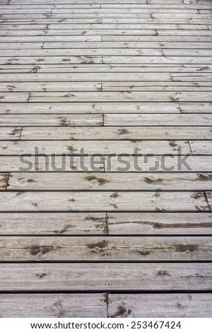 Wooden floor constructed from teak wood lumber planks for background and texture - stock photo