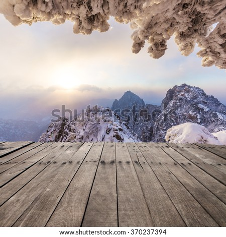 wooden floor front of snow scene of Huangshan hill  - stock photo