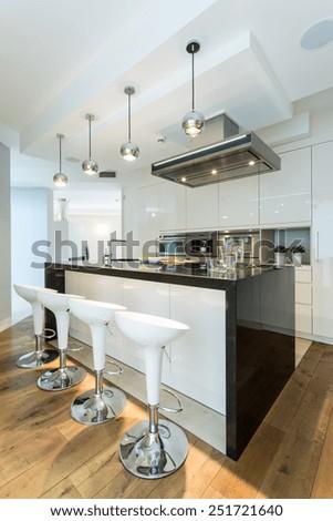 Wooden floor in a modern bright kitchen - stock photo