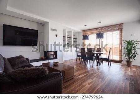 Wooden floor in cozy drawing room interior - stock photo
