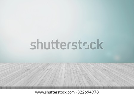 Wooden floor in light white grey/ gray color tone with blurred abstract background of clouds and sky bokeh and sun flare in vintage color tone for interior decoration and product  placement  - stock photo