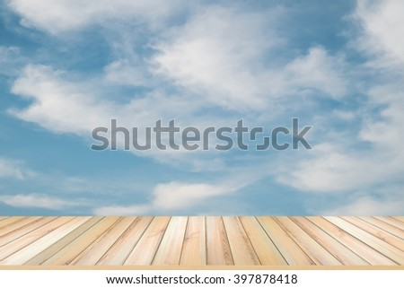 wooden floor with blue sky and cloud background - stock photo