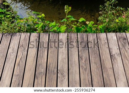 Wooden floor with lake - stock photo