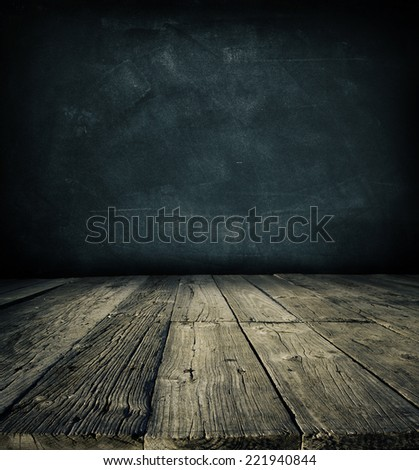 Wooden floorboards and dark wall - stock photo