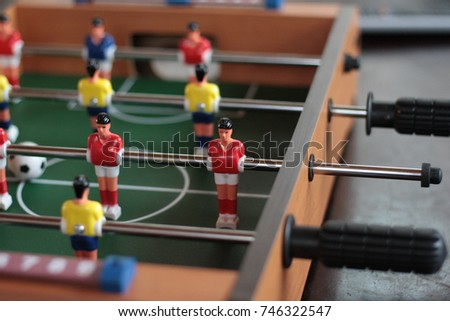 Wooden foosball table detail.