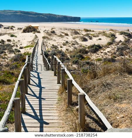 Wooden Footbridge across the Sand Dunes on the Atlantic coast of Portugal - stock photo