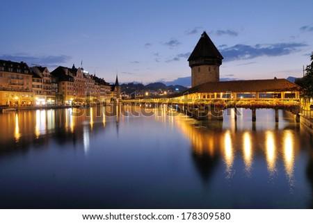 wooden footbridge in Lucerne, Switzerland  - stock photo