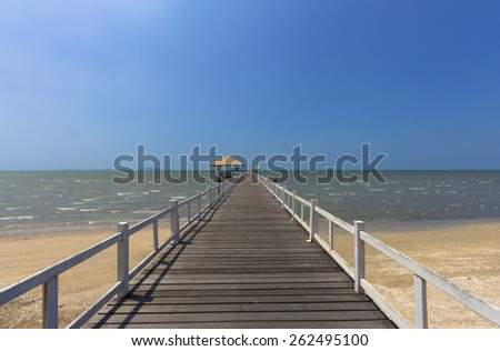 Wooden footbridge in sea view on the beach - stock photo