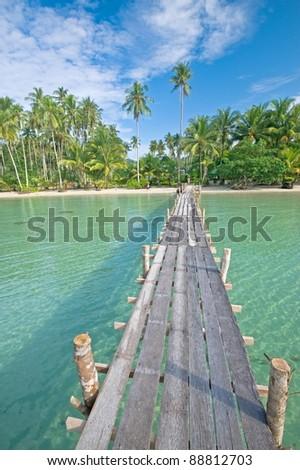 Wooden footbridge to the beach of Kut island, Thailand - stock photo