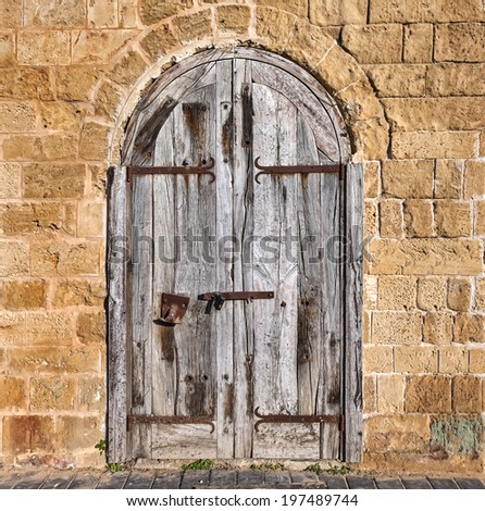 Wooden forged closed doors (gate) of the old Mediterranean house.Tel Aviv, Israel - stock photo