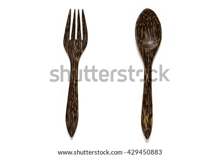 Wooden fork and wooden spoon isolated on white background.