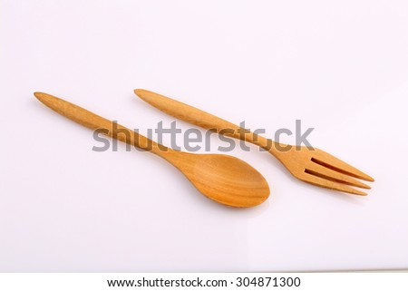 Wooden fork and wooden spoon made by Teak isolated on white background. - stock photo