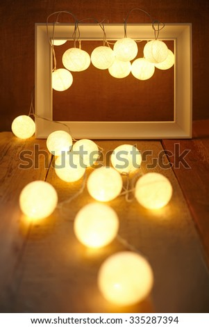Wooden frame and garland. Abstract composition - stock photo
