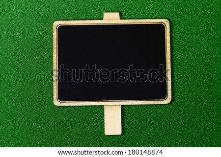 wooden frame isolated green background - stock photo