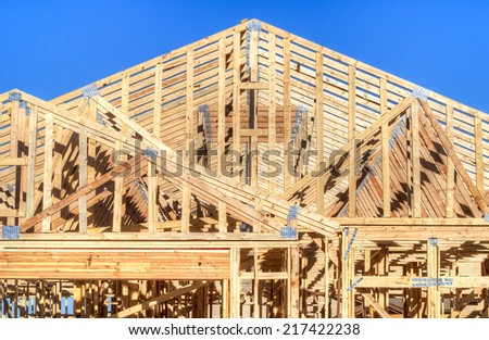 Wooden frame of an residential house under construction - stock photo