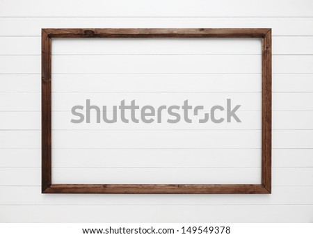 wooden frame on white wall - stock photo