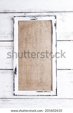 Wooden frame on wooden background - stock photo