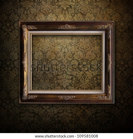 Wooden frame over grunge wallpaper - stock photo