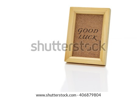 """wooden frame with fill isolated on white paper, write """"GOOD LUCK"""" - stock photo"""