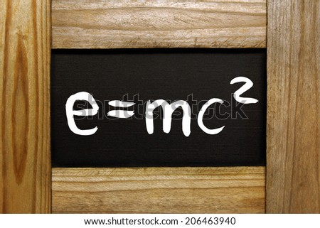 wooden frame with handwritten e=mc2  - stock photo