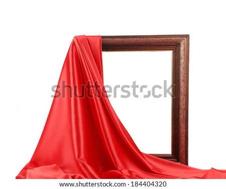 Wooden frame with red silk. On a white background. - stock photo