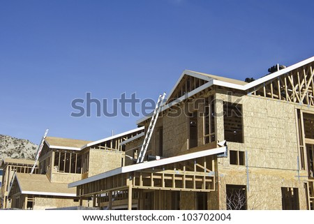Wooden frames of new homes being built. - stock photo