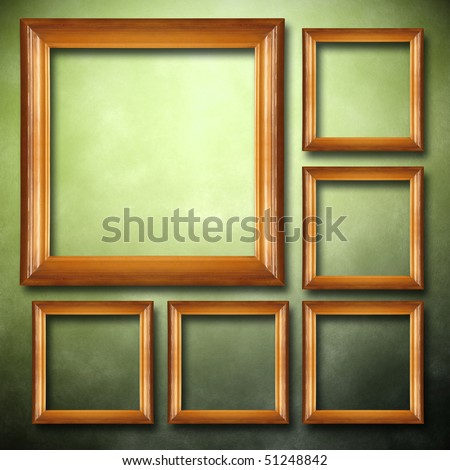 wooden frames on grunge wall