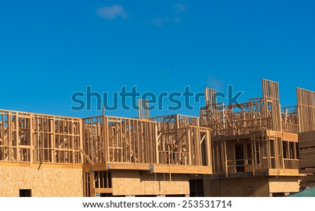 Wooden framing for construction of new condominiums, apartments or townhomes - stock photo