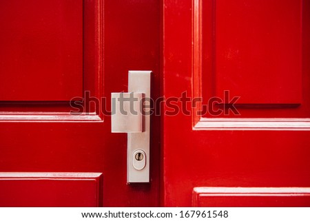 Wooden front door (doorway) in Traditional Georgian architecture freshly painted in red color - stock photo