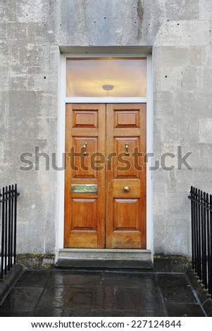 Wooden Front Door of a Georgian Era Town House - stock photo