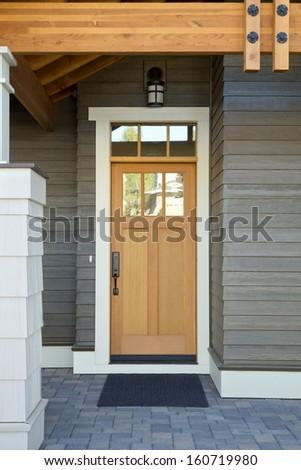 Wooden front door of a home - stock photo