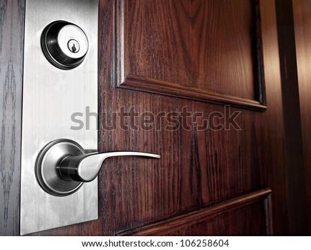 Wooden Front Door with  Stainless Steel Handleset - stock photo