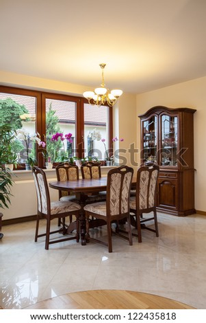 Wooden furniture in the bright dining room