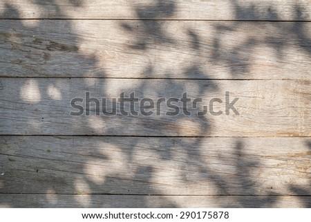 Wooden garden table on sunny day - stock photo