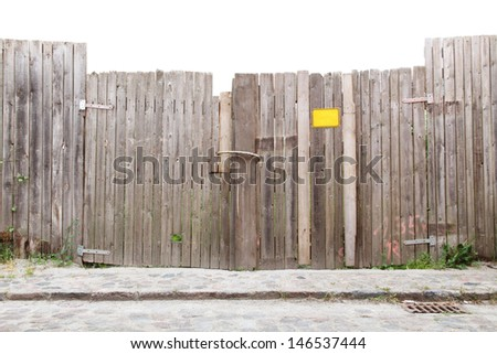 Wooden gate at a cobbled street/Wooden Fence and Gateway - stock photo