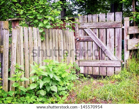 wooden gate at an old fence