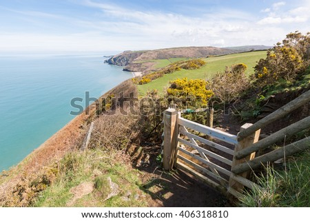 Wooden gate leading onto the Cardigan Bay Coastal Path. Penbryn Beach can be seen in the distance.