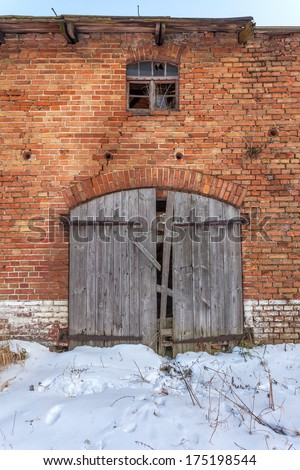 Wooden gate to the old, forgotten barns - stock photo