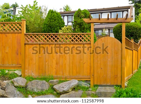 Wooden gate ( wicket )  and fence to the front ( back ) yard. - stock photo