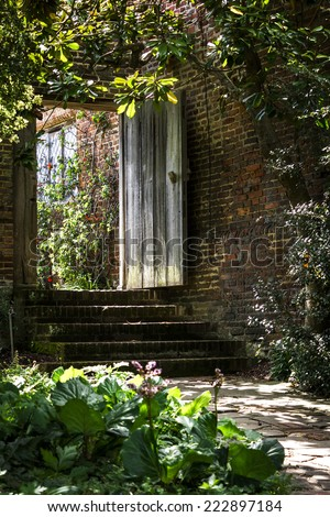 Wooden gated entrance to a garden at Sissinghurst Castle in Kent, UK - stock photo