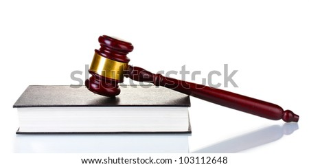 wooden gavel and book isolated on white - stock photo