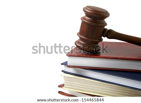Wooden gavel and books isolated on white background - stock photo