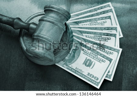 Wooden gavel and dollars on wooden background - stock photo