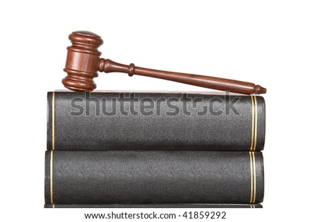 Wooden gavel and law books isolated on white background. Shallow depth of field - stock photo