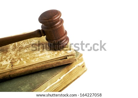 Wooden gavel and vintage books on a white background