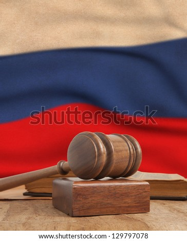 Wooden gavel and vintage France flag - stock photo